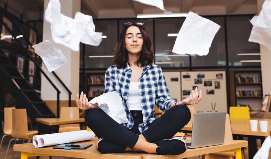 woman meditating on desk from pms cramp relief
