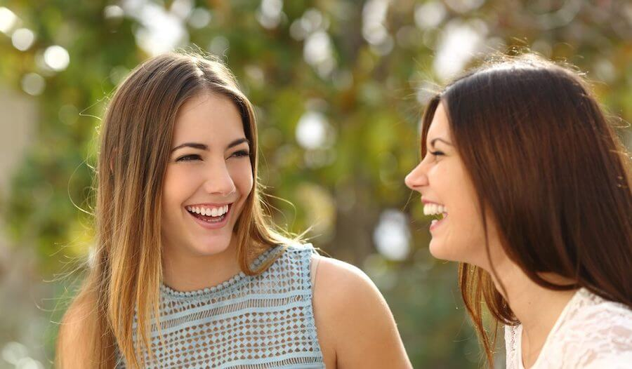 healthy women friends with healthy skin smiling