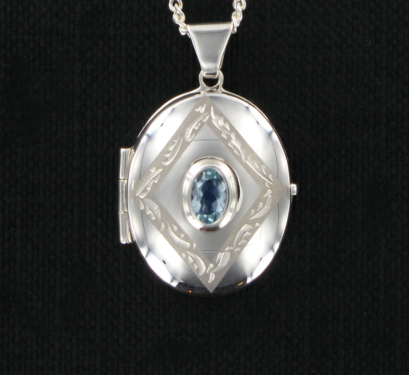 "Blue Topaz Oval Locket & 18"" Curb Chain"