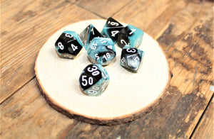 High Quality Chessex dice from Fandomonium. Gemini Black Shell Polyhedral dice set