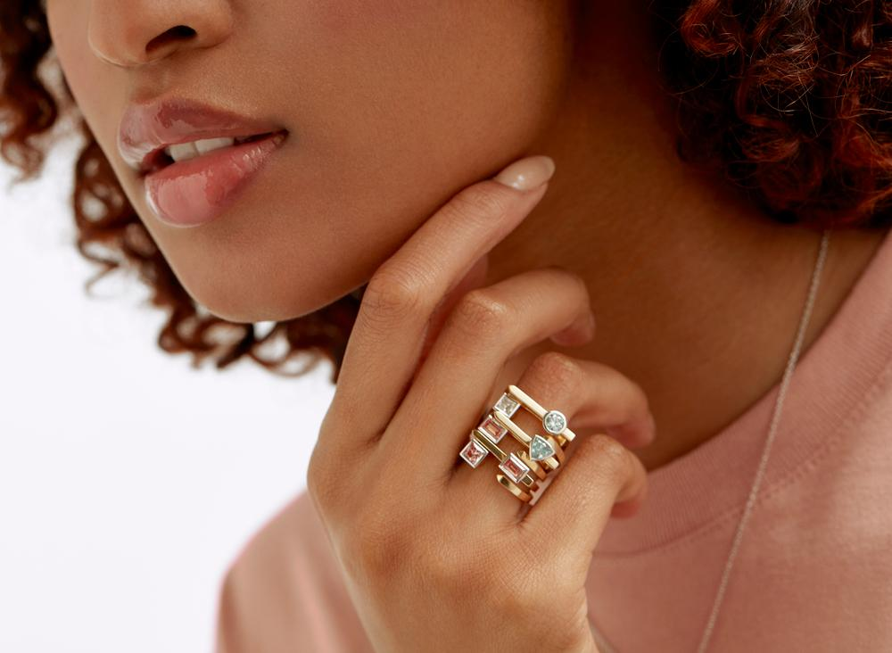 On model view of Trillion open top 3/8 carat ring with white diamond