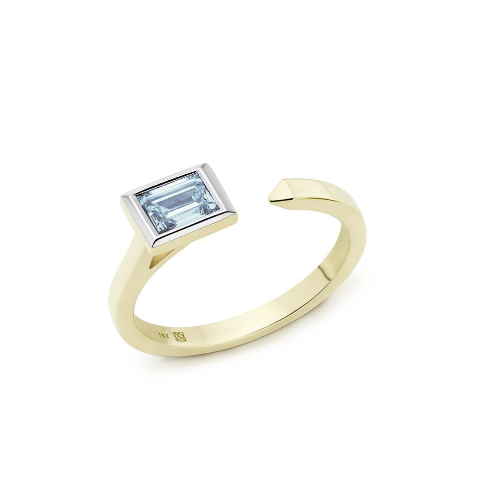 Side view of Baguette open top 3/8 carat ring with blue diamond