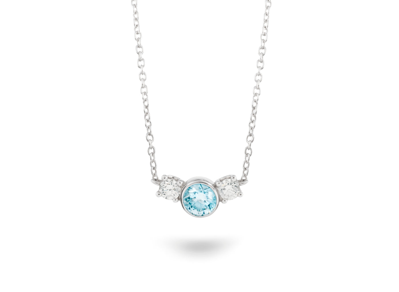 Front view of Three Stone 3/4 carat pendant with blue and white diamonds