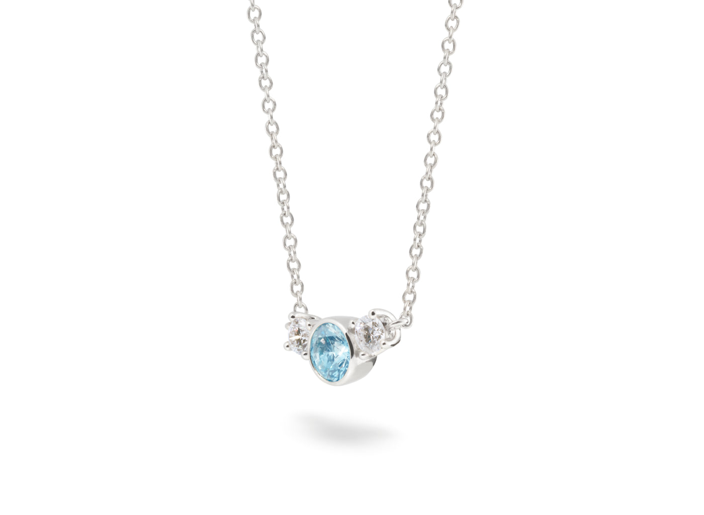 Side view of Three Stone 3/4 carat pendant with blue and white diamonds