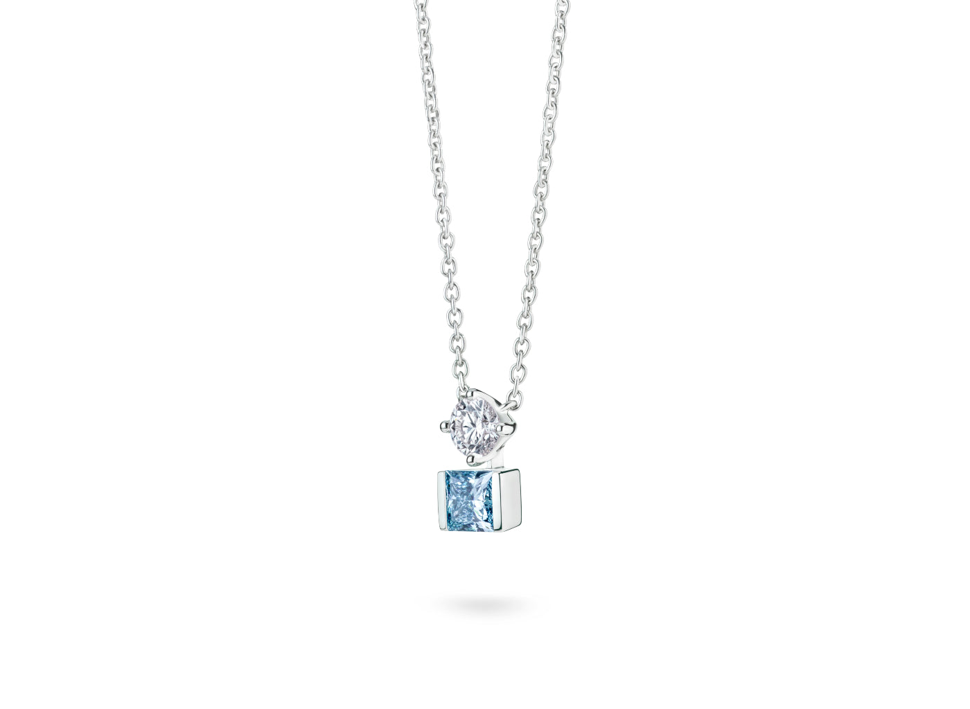 Side view of Mismatched Two Stone 1 carat pendant with blue and white diamonds