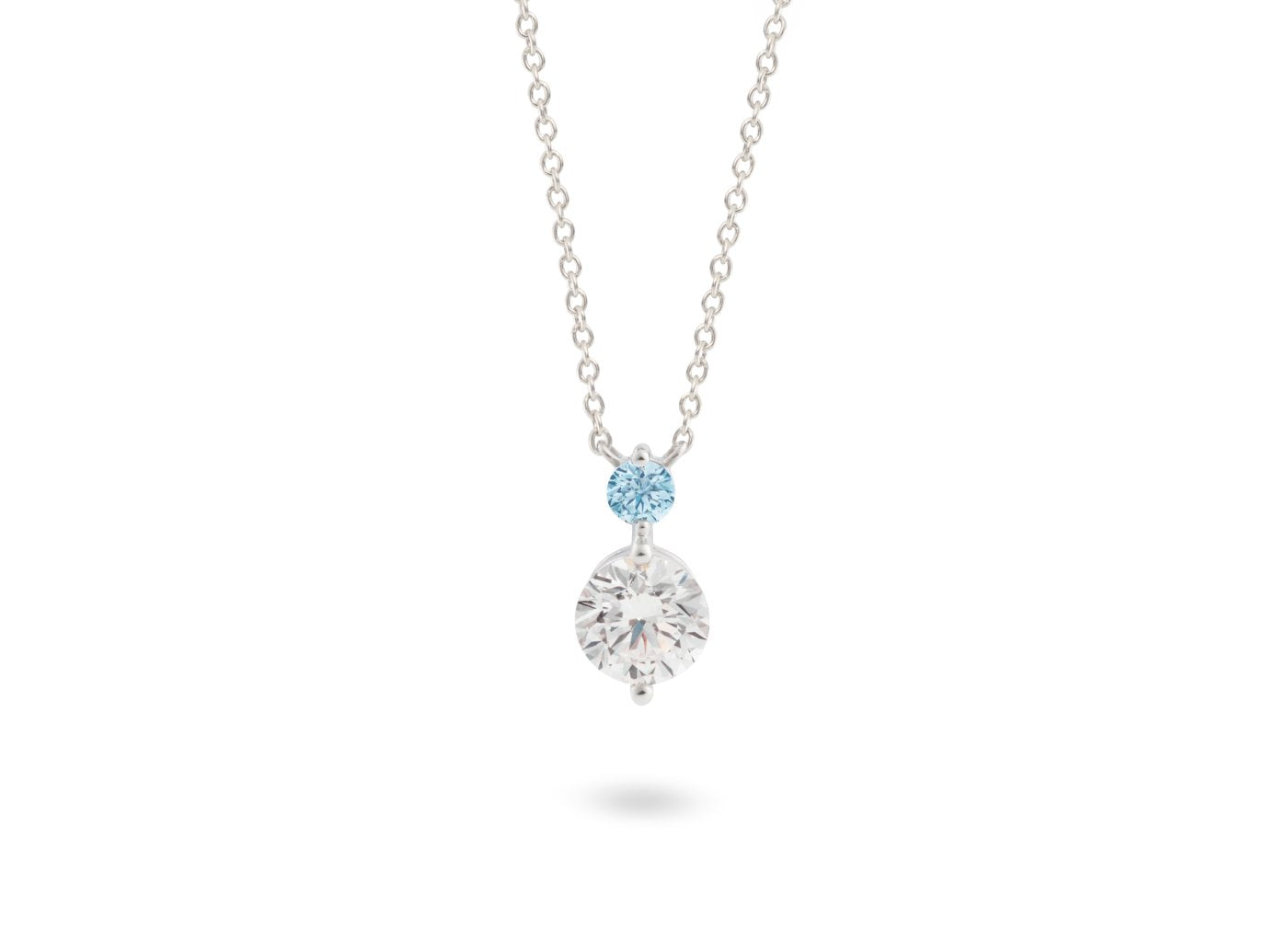 Front view of Tow Stone 1 carat pendant with blue and white diamonds