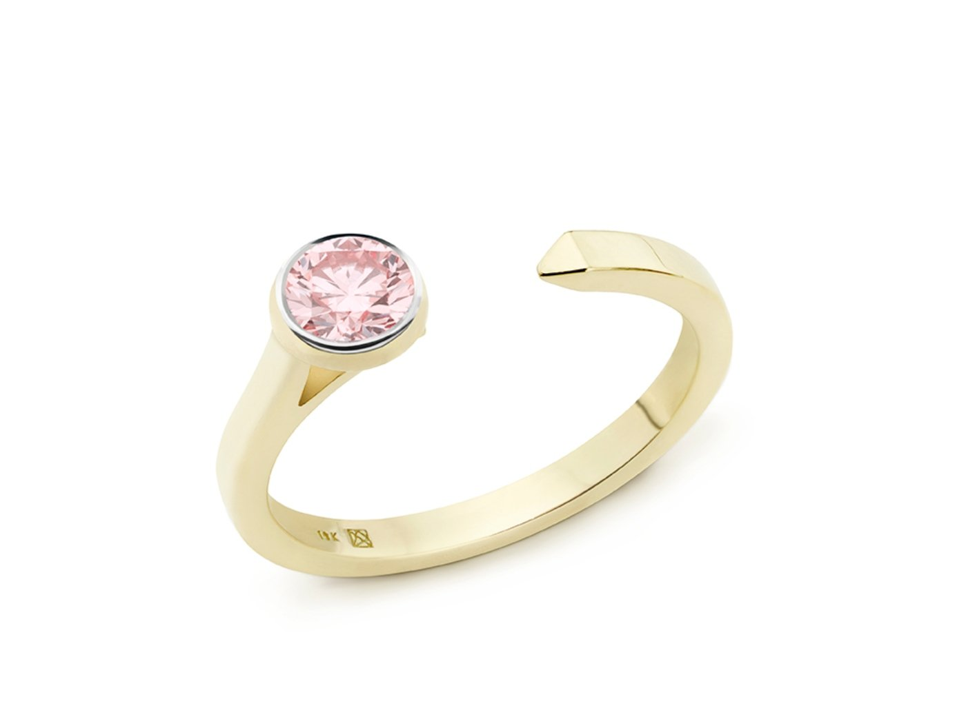 Side view of Solitaire open top 3/8 carat ring with pink diamond