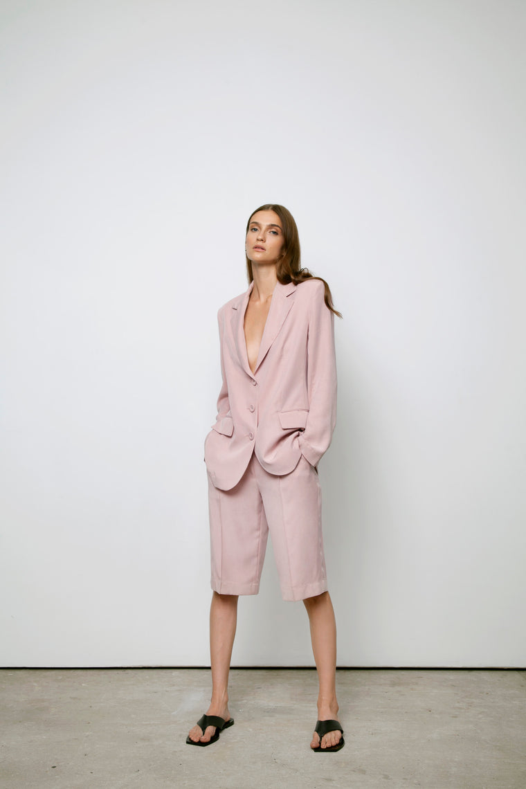Pink powder suit. Jacket with shorts