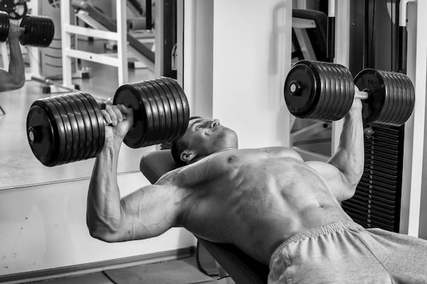 man doing an incline dumbbell press