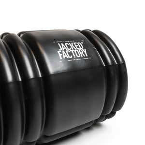 Close up of logo on Jacked Factory's Black foam roller with a white Jacked Factory logo
