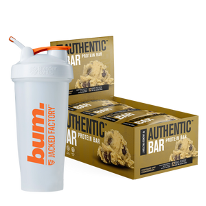 Jacked Factory's 12-pack of Chocolate Chip Cookie Dough Authentic Bars in a brown box with cookie dough image next to a white and orange bum. shaker bottle