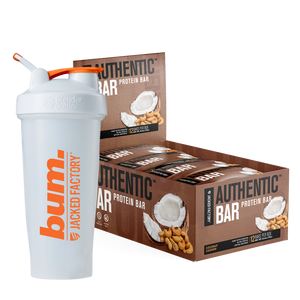 Jacked Factory's 12-pack of Coconut Cashew Authentic Bars in a brown box with coconut & cashew image next to a white and orange bum. shaker bottle