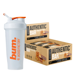 Jacked Factory's 6-pack of Kitchen Sink Authentic Bars in a beige box with pretzel and chocolate image next to a white and orange bum. shaker bottle