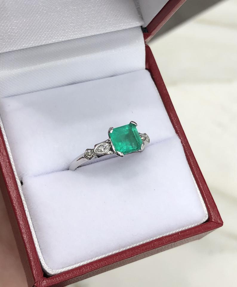 1.47tcw Emerald & Diamond Accent Ring