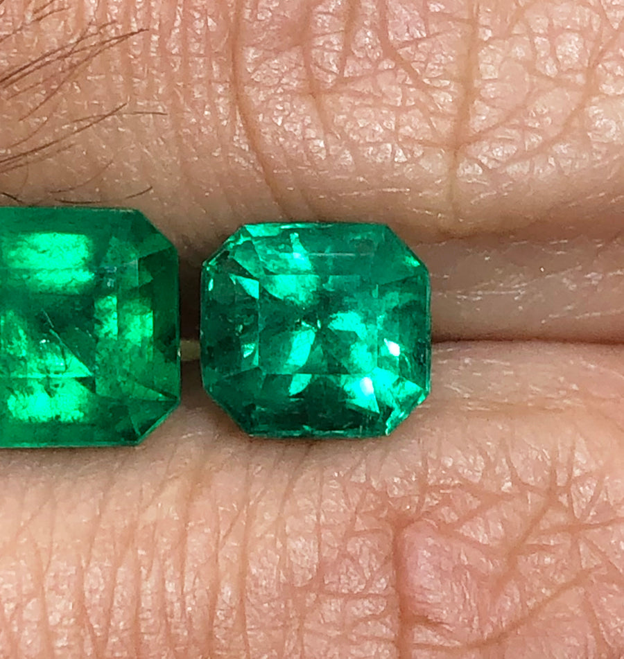 1.87 Carat Colombian emerald and trillion three stone platinum and 18K yellow gold ring