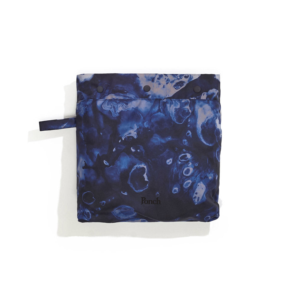 Packed away image of blue Leif Podhajsky print packable rain Poncho by Ponch
