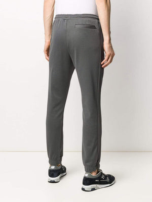BOSS Slim-fit jogging trousers with curved logo - Maison De Fashion