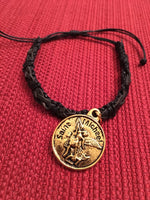 Police Jewelry Gold Colored Charm on Black Leather Bracelet