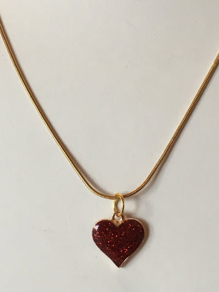 Heart Shaped Charm Necklace on Gold Colored Snake Chain that's Adjustable