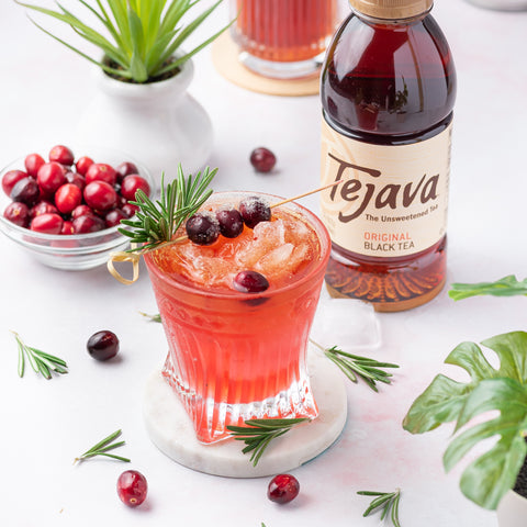 Tejava black tea with cranberry syrup cocktail