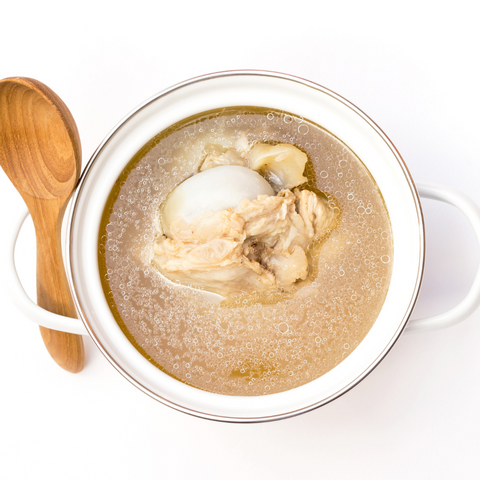 bowl of bone broth for cats and dogs, pork bones for dogs, is bone marrow good for dogs
