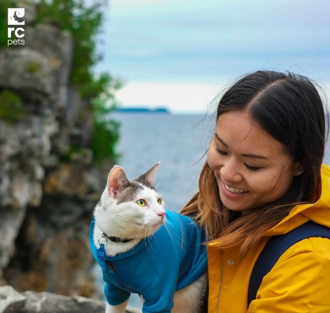 cat with human parents on outdoor adventure