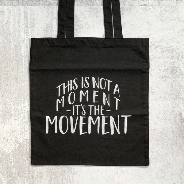 NOT A MOMENT tote bag