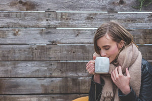 girl sipping coffee mug