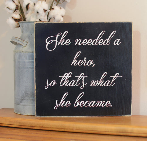 She Needed A Hero Wood Sign