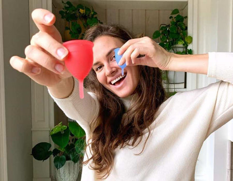 woman with menstrual cups