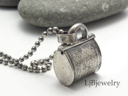 Silver purse pendant necklace