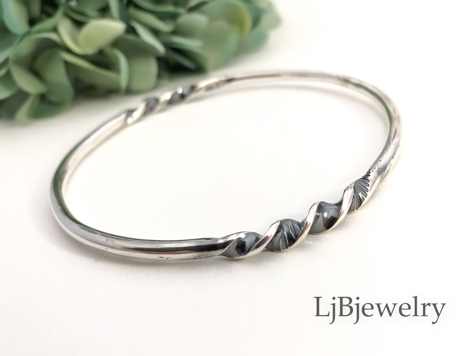 chunky silver twisted bangle bracelet