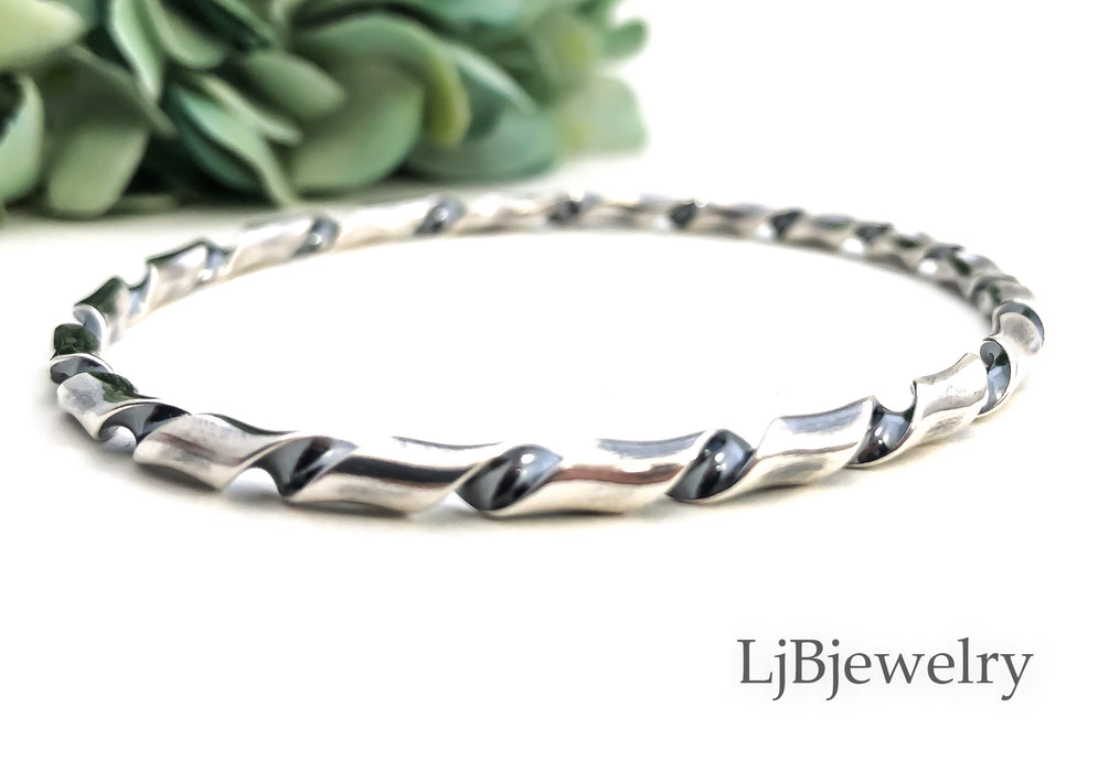 silver twisted stacking bangle