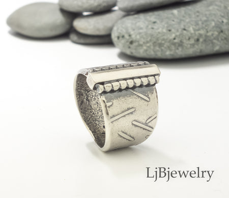 sterling silver textured saddle ring