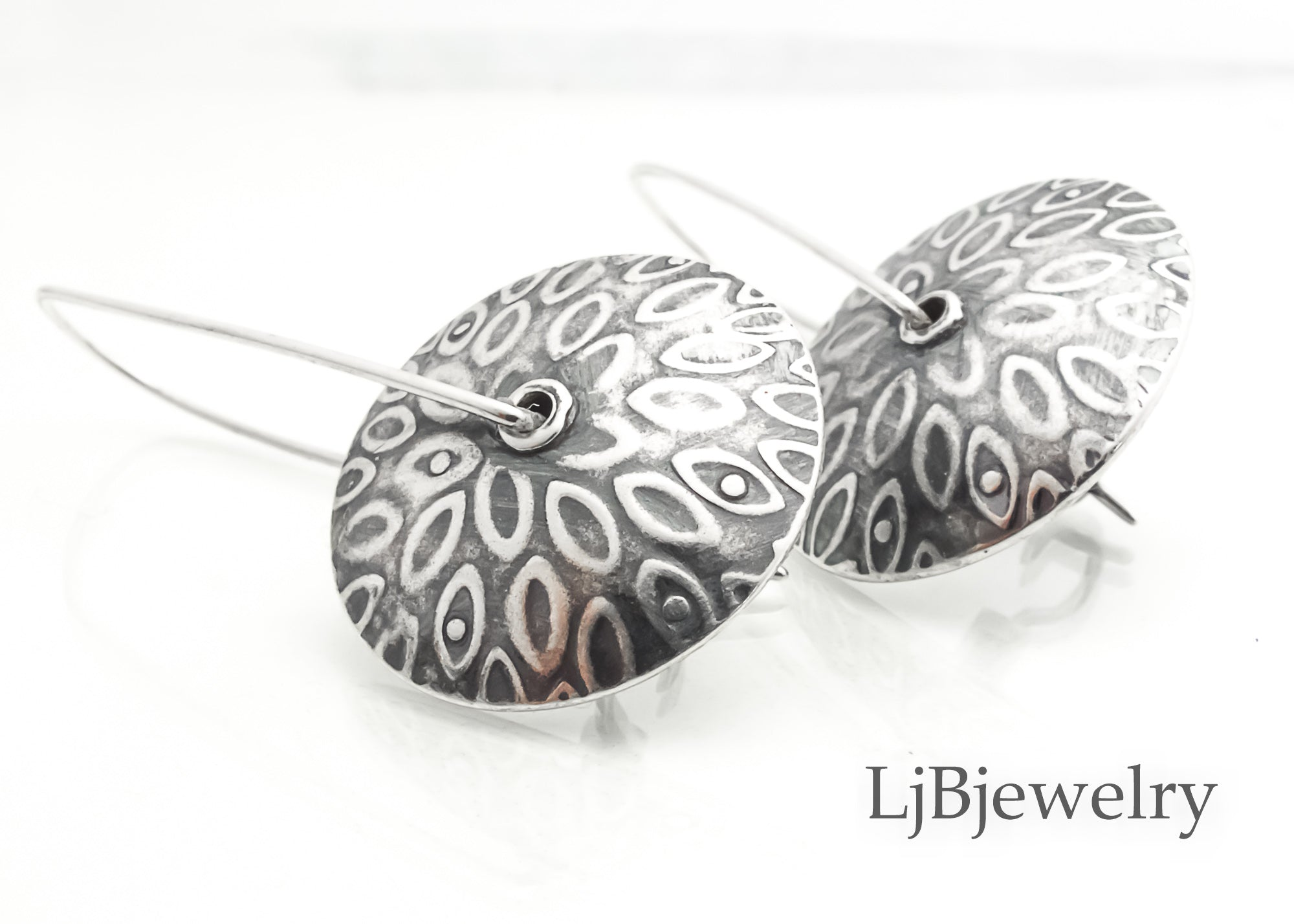silver textured dangle earrings