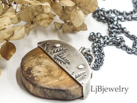 silver pendant with leaf design