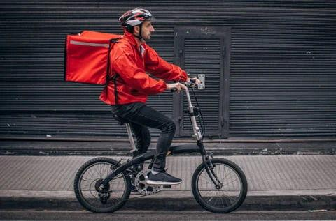 Delivery Guy on his way to deliver food on his Ebike