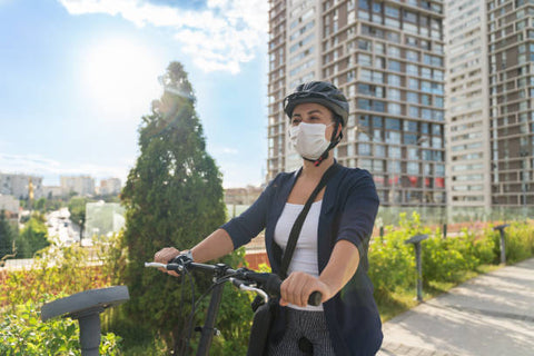 Female Commuter on her way to work on an Ebike
