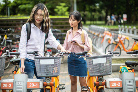 Female students about to ride their ebikes