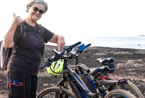 Happy Elderly woman with her  Electric Bike