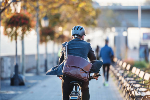 Man on his way to work on his ebike