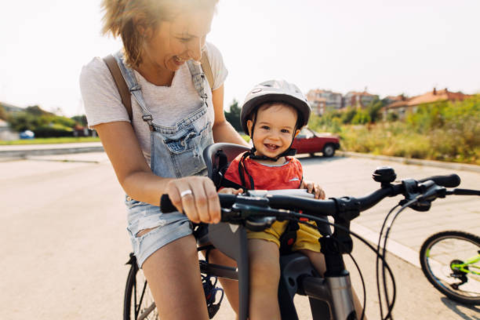 Mother  riding her baby on her Ebike