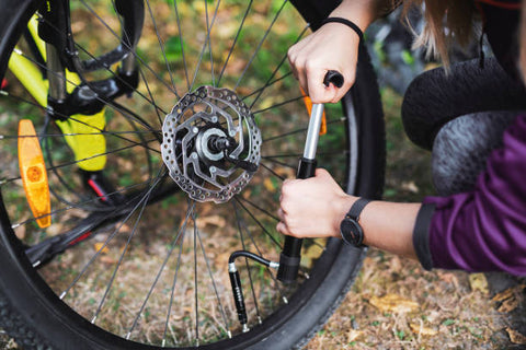 Pumping air pressure on the Electric Mountain Bike tire