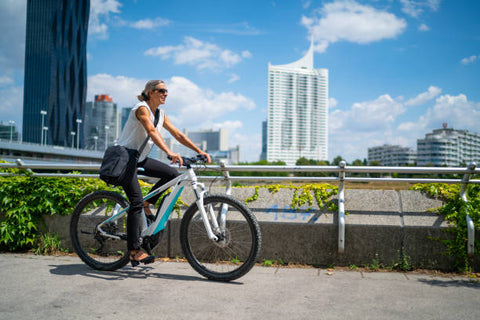 Woman Riding an Ebike around the city