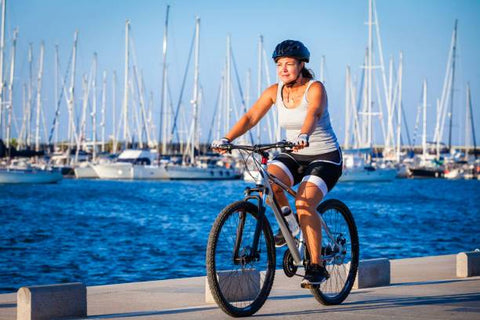 Woman on an Electric Bike by the Marina