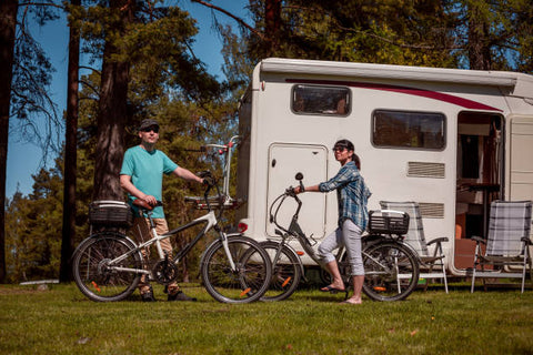 Woman with a man on electric bike resting at the RV campsite.