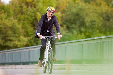 Working Commuter on his way to work an Ebike
