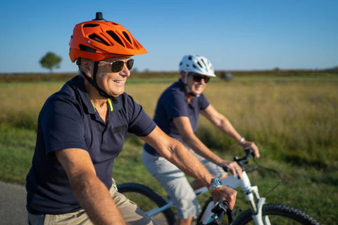 happy senior men cycling together on an  ebike