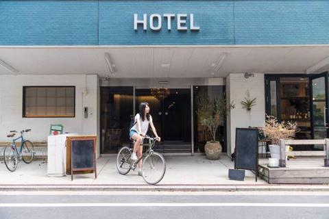 tourist coming out from the hotel riding an ebike