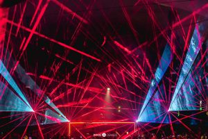 Red and Blue Lasers Shining throughout the room during Martin Garrix performance at Green Valley night club